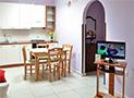La cucina di un'appartamento del Residence Blue Marlin