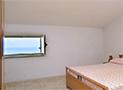 La camera da letto con vista mare