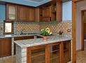 La cucina attrezzata dell'appartamento Le Acacie Comfort