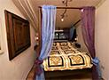 La camera con letto a baldacchino