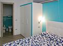 La camera matrimoniale dell'appartamento Bora