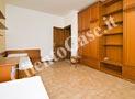 La camera da letto ha due letti singoli con due aggiuntivi