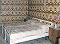Una camera da letto matrimoniale di Casa Emilia
